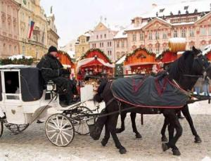 Old-fashioned carriages are one mode of transportation in Prague during the holiday season