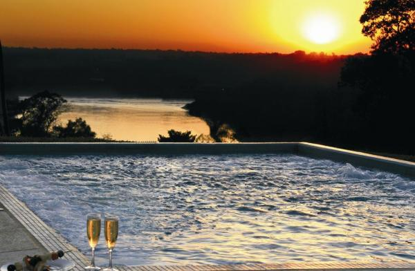 Enjoy spectacular sunsets over the confluence of the Iguazu and Parana rivers