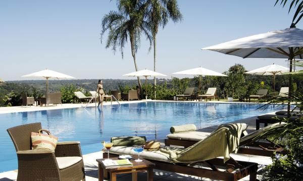 Relax poolside at Panoramic Hotel