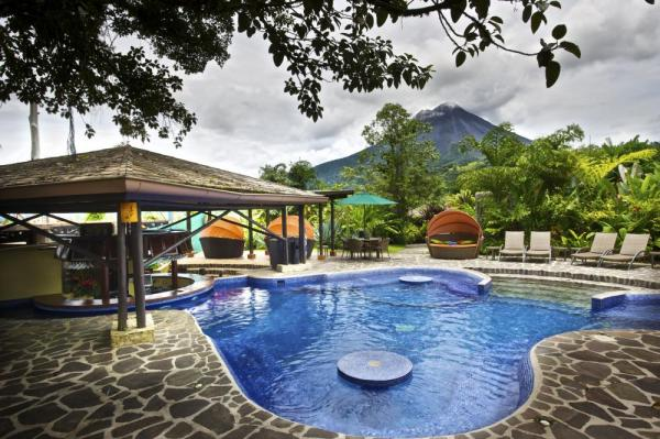 The pool features a volcano view