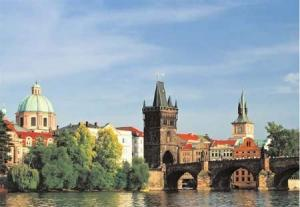Walk the riverfront of Prague, one of the most beautiful of European cities