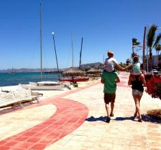 A family walks the beach in La Paz