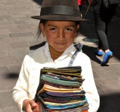 Adorable Peruvian girl selling scarves
