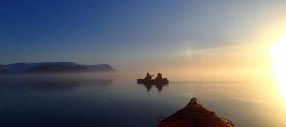 Sunset while kayaking at floe edge