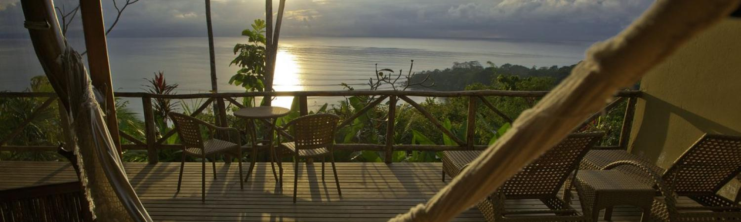 Bid the sun goodnight from your hammock at Lapa Rios Ecolodge