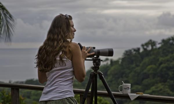 A traveler surveys Costa Rica from the deck of Lapa Rios Ecolodge