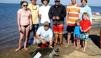 A family participates in sea turtle research in Magdalena Bay