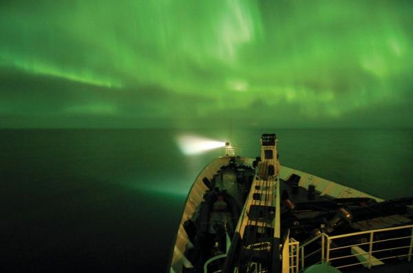 View the stunning aurora borealis from the deck of your expedition cruise ship