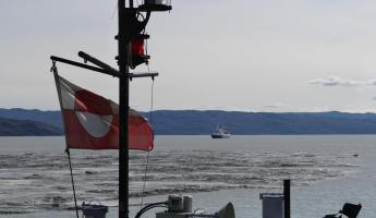 Greenland flag with Sea Adventurer in background