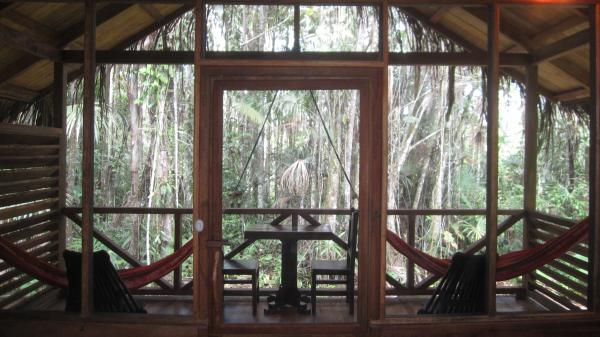 Cozy up in one of the bungalows at Sacha Lodge