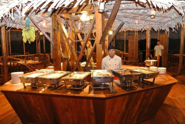 Enjoy fine dining at Sacha Lodge