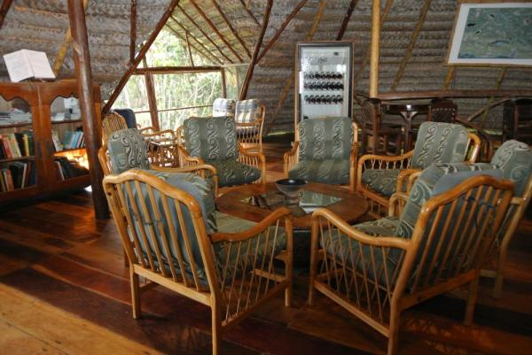 Relax in the lounge at Sacha Lodge