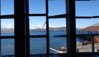 View from window of abandoned fishing village in Greenland