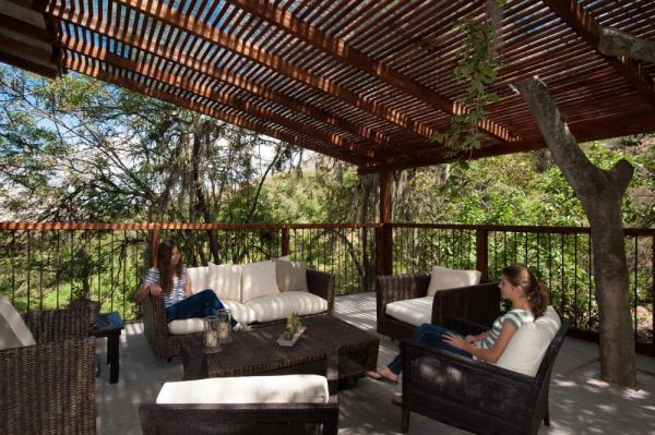 Relax in the covered outdoor lounge at Hacienda Piman
