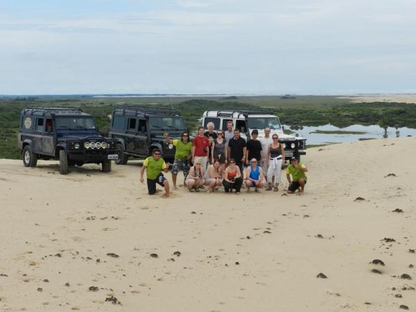 Travelers in front of their transportation across the dunes, Jericoacoara