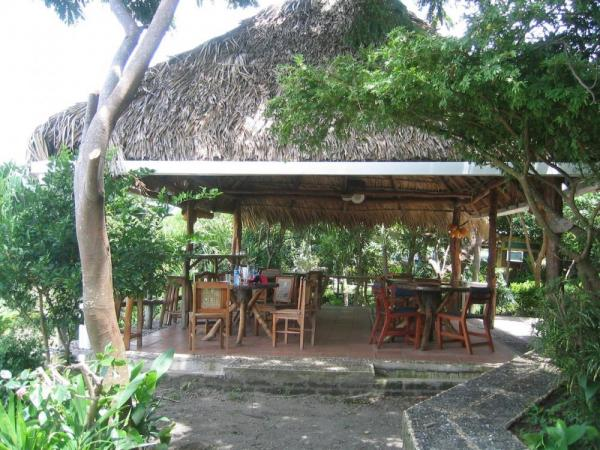 Enjoy your meals at the outdoor dining room of Villa Paraiso Hotel