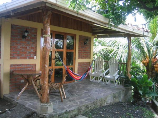 Stay in a comfortable cabin at Villa Paraiso Hotel