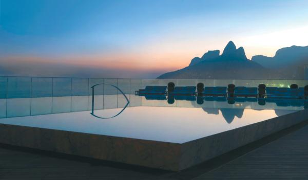 Catch the last rays of sun from the pool at Experience exceptional cuisine at Hotel Fasano Al Mare