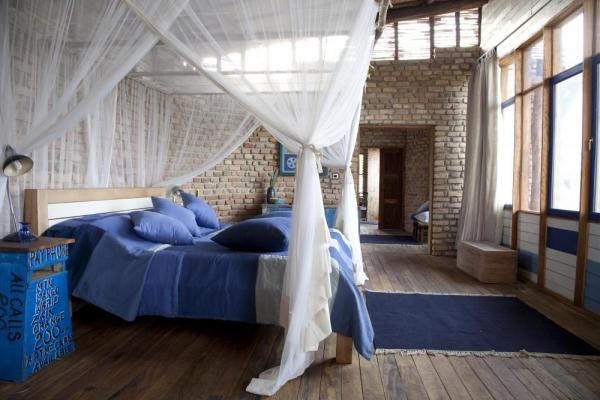 Enjoy the spacious and comfortable rooms at the Kyambura Gorge Lodge