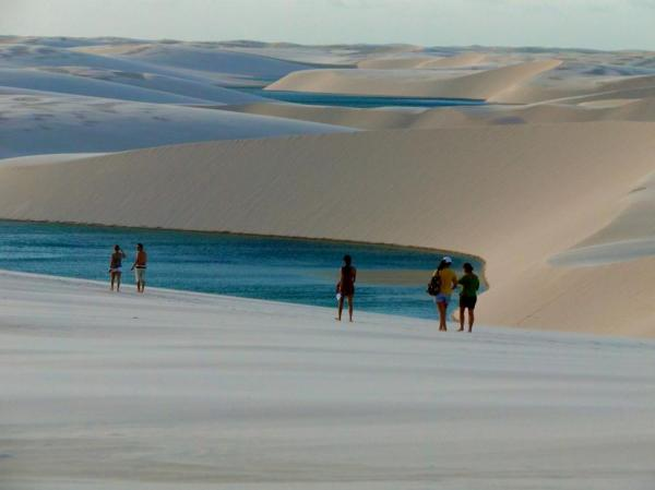 Trekking through Swimming in the clear lagoons of Lencois Maranhenses