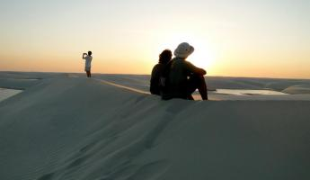 The sun dips below the sandline in Lencois Maranhenses