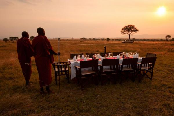 Enjoy a sunset meal outdoors at the Lemala Elewanja Camp