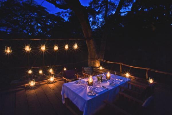 Enjoy outdoor dining at night at Gibb's Farm