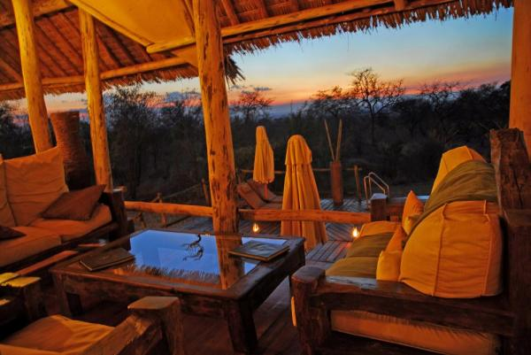 Enjoy the sunset from the open porch at Tarangire Treetops Lodge