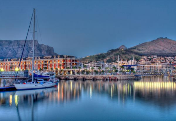 The Cape Grace Hotel in Cape Town looks beautiful on the water at night