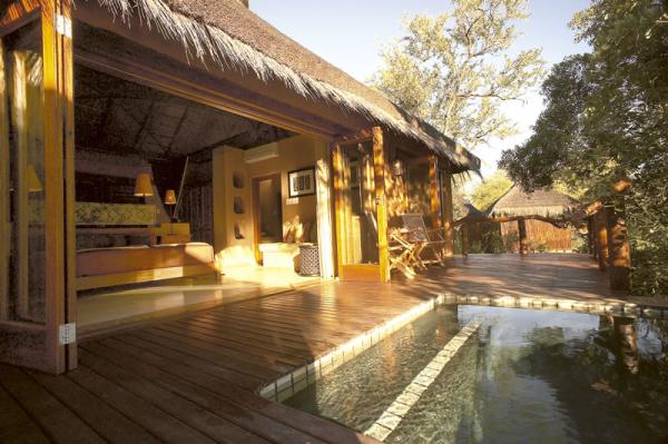 Relax by the pool at Simbambili Lodge