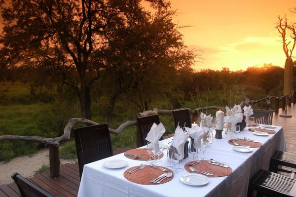 Simbambili Lodge's outdoor dining area is beautiful at sunset