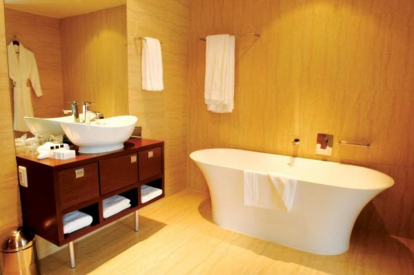 The modernly designed bathrooms at the Pepper Club Luxury Hotel and Spa.