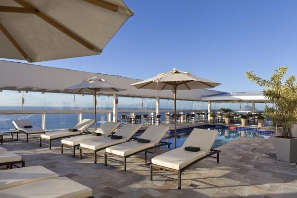 Relax on the pool deck of Othon Palace