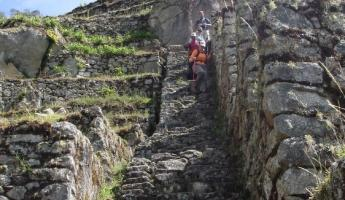 Travelers on exploring ruins on the Inca Trail - Day 3