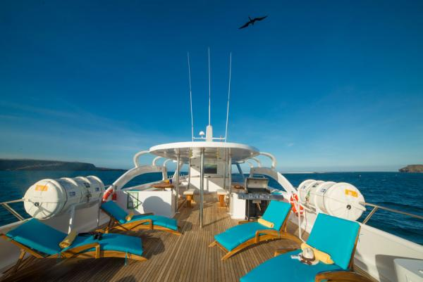 The sun deck offers panoramic views of the Galapagos archipelago