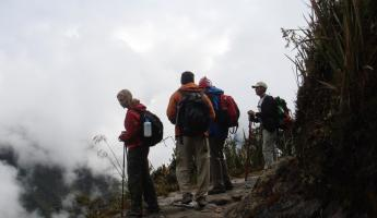 Travelers overlooking the overwhelming landscape of the Andes on the Inca Trail