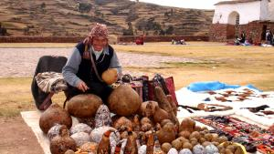 Skilled craftsman outside of the market in Chinchero, Peru