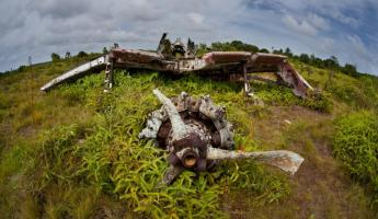 View the wrecks of Japanese Zeros on the island of Yap