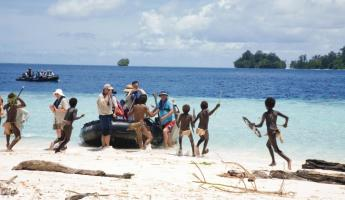 Children of the Solomon Islands greet your zodiac