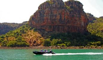 Take a zodiac past the dramatic landscape of Australia