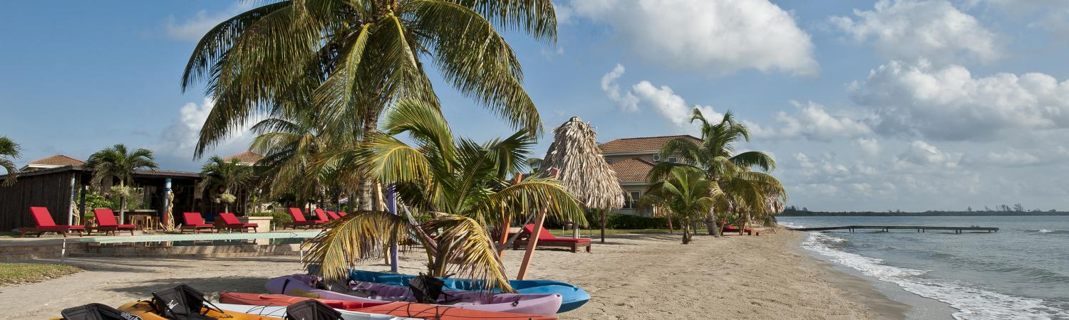 Complimentary kayaks wait ready for you on the beach at Hopkins Bay Resort