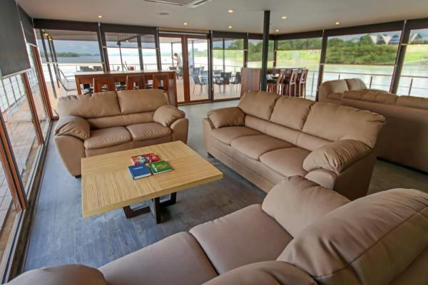 Relax in the sitting lounge aboard the M/V Anakonda