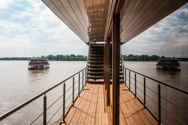 Walk the elegant outdoor decks of the M/V Anakonda