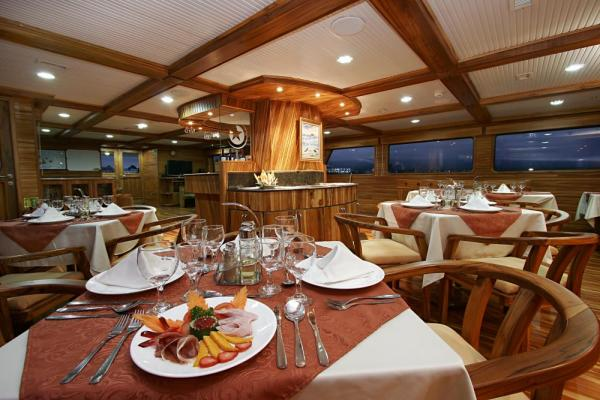 Enjoy fine dining aboard the Galaxy on your Galapagos cruise