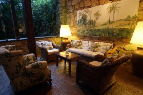 Relax in the lounge at Pousada do Ouro
