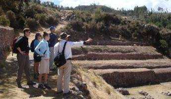 Listening to our guide, Marco, near the Inca ruins of Sacsayhuaman