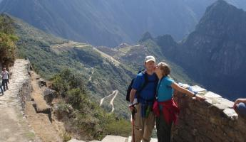Celebrating with a kiss at the Sun Gate - entrance to Machu Picchu