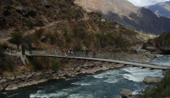 Crossing a foot-bridge at the beginning of the Inca Trail
