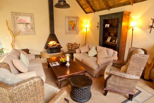 Relax by the fire at the Tongabezi Lodge