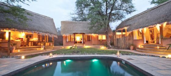 Relax and enjoy the refreshing pool at the Tongabezi Lodge